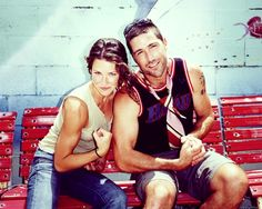 Kate and Jack (Evangeline Lilly  Matthew Fox) on LOST showing their guns. . .she has the best arms! i spend most of the time we're watching trying to figure out her workout regime. Thus far, I think I need to climb trees!