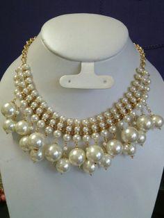 Collar perlas.