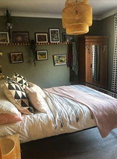 "We have all had a boring wall that needs ""something"" but we are stuck for imaginative ideas of what we can do. Let me share with you what I did in my bedroom recently. Its super simple, really cheap to do and looks so effective. Pottery Barn Mirror, Faux Wood Wall, Wooden Kitchen Signs, Faux Marble Countertop, Coat Pegs, Make A Closet, Builder Grade Kitchen, Displaying Kids Artwork, Patio Chair Cushions"