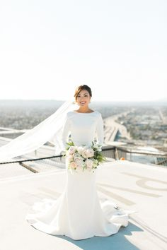 Modest wedding dresses any bride would love: http://www.stylemepretty.com/2016/02/02/modest-wedding-dresses/