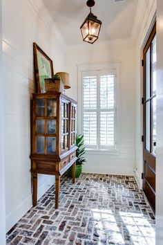 Maybe use the brick from exterior to brick mudroom floor? Brick floor - love - Smythe Park Home in Daniel Island, SC by JacksonBuilt Custom Homes Design Entrée, House Design, Lobby Design, Custom Home Builders, Custom Homes, Style At Home, Style Blog, Sweet Home, Brick Flooring