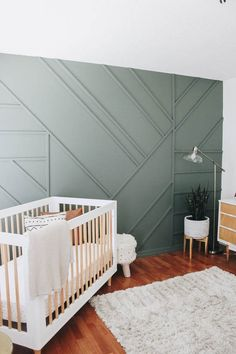 DIY Modern Wood Accent Wall + Neutral Nursery Creating a feature wall doesn't have to be hard or expensive. This modern wood accent wall can be completed in a day while completely transforming a space. Wooden Accent Wall, Accent Wall Bedroom, Wall Wood, Wood Wall Design, Accent Walls In Living Room, Accent Wall Decor, Bedrooms With Accent Walls, Wood Wall Nursery, Diy Wooden Wall