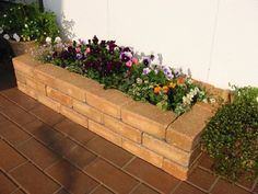 Image result for brick flower beds on a hill