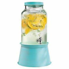 Serve fresh lemonade or herb-infused water with this charming glass beverage dispenser, showcasing a galvanized metal base and lid in blue.  Product: Beverage dispenserConstruction Material: Galvanized metal and glassColor: Blue and clearFeatures: 1.5 Gallon capacity