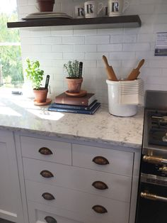 Farmhouse Kitchen Street of Dreams - The Inspired Room. Brick look subway tile.