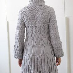 This sweater coat is worked from the top down. The cables are carefully arranged to give a slimming silhouette without adding extra bulk.Measurements are given in both centimeters and inches.The yoke and the cables are charted only. Each size has its own set of charts, which are printed full size for easy reading.