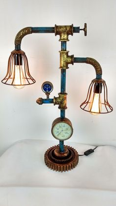 https://www.ebay.de/itm/Industrie-Design-Lampe-aus-Wasserrohren-Leuchte-Pipe-Art-Steampunk-Retro-Fabrik/162115327284?hash=item25bed39534:g:RMwAAOSw8UZaCKI-