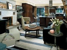 I love the interior designer Candace Olson's makeovers because the spaces always have the perfect balance between being both modern and sophisticated. She is amazing! :)