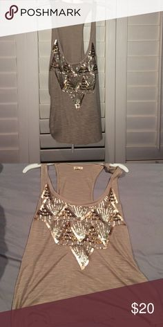 Hollister tank It's a gold tank, with gold rhinestones on it. It's never been worn. The front is low Hollister Tops Tank Tops