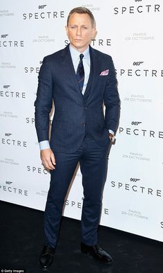 Guess who's back: The man of the moment Daniel Craig, 47, put on a dapper display in a blu...