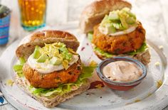 These subtly-spiced veggie burgers, with zingy sweet potato & avocado, are gluten-free & totally tasty! See more barbecue recipes at Tesco Real Food.
