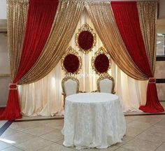 Red and Gold Ivory Red Rose Flower Wall Frame Backdrop Decor Ideas Wedding Reception Maharani Southasian Mehndi Afghan Stage ideas Gold Champaign Sequin Backdrop with Peach Coral Draping Sweet Heart Table Design Decor Ideas @iDesignEvents
