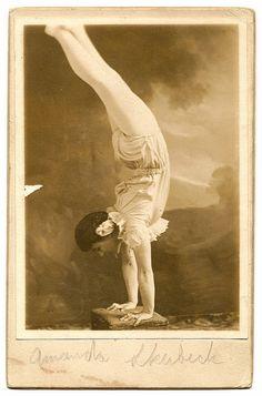 Acrobat Performing Handstand