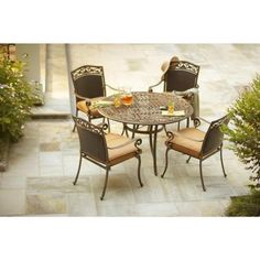 Shop for Outdoor Patio Furniture at The Home Depot. Add a splash of sophistication to your backyard soiree with the help of the Miramar II Patio Dining Set. This 5-Piece set includes 1 table and 4 dining chairs. Cast-aluminum frames have an aged bronze finish for a refined appeal. Lush, overstuffed cushions offer comfortable seating for family and friends. Perfectly complements other Miramar II Collection items (sold separately).'