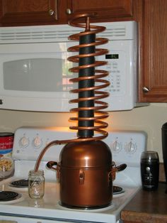 Stove top distilling with the 2 gallon SuperCoil distiller. So easy anyone can do it. fueldistillation.com/supercoil.html Ethanol Fuel, Copper Still, Survival Prepping, Survival Tools, Making Essential Oils, Wine Making, Home Brewing, Diy Projects To Try, Distillery