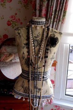 Mannequin and pearls