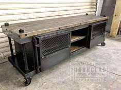 This media console is in my Pressfield line. It features a solid wood top, wood shelves, and a steel body. This item can be configured to any dimension desired. This unit can also be used as a bar cart, or a credenza. Size, options, and shipping location determine final price.