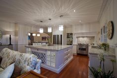 A kitchen inspired by the French Provincial style. Now that is an island bench! Cape Cod Style House, Architrave, Queenslander, Energy Efficient Homes, Timber Flooring, Beautiful Kitchens, Kitchen Styling, The Hamptons, Colonial