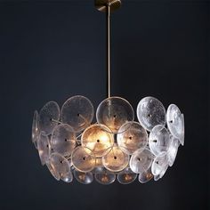 "Glass Disc Chandelier | west elm      Overall product dimensions: 24""diam. x 10.1""h.     Length from lamp to ceiling adjusts incrementally from 20"" - 56"" (includes three 12"" rods and one 6"" rod).     Accommodates four 13W CFL bulbs (included) or 40W incandescent bulbs (sold separately).     UL listed. $499"