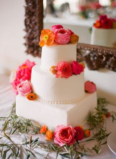 sometimes the perfect accompaniment to a pretty white #cake is colorful blooms | Photography by esthersunphoto.com, Cake by http://santabarbaracakes.com  Read more - http://www.stylemepretty.com/2013/09/26/san-ysidro-ranch-wedding-from-esther-sun-photography/