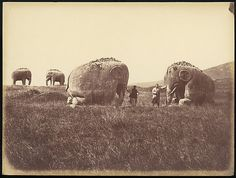 Two Men by Monumental Elephant Statues, China. 1860.