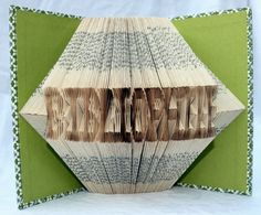 Bibliophile  Book Origami by rhymeswithmagic on Etsy, $65.00 - neato