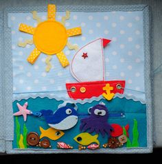 Boat sails across the page on string. Whale and octopus hide inside the zippered pocket.