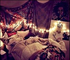 Cozy boho winter room with lots of pillows curtains and string lights for that magical atmosphere