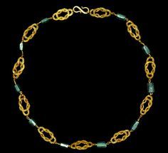 Roman Gold and Emerald Necklace | Circa 3rd-4th century AD | A composite necklace comprising eleven double-loop filigree plaques connecting ten hexagonal-section emerald cylinders; with loop and s-hook closure | 18 grams, 37.5 cm