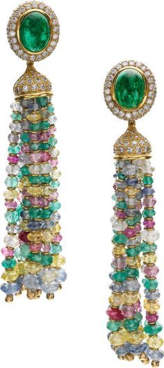 Diamond, Multi-Stone, Gold Earrings The earrings feature oval-shaped emerald cabochons approximately 4.20 carats, enhanced by full-cut diamonds weighing a total of approx 3.70 carats, set in 14k gold, supporting detachable tassels composed of faceted emerald, sapphire, ruby and beryl beads, accented by gold spacer beads, completed by posts with omega clips on the reverse.