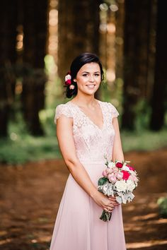 Soft pink lace bridesmaid dress with natural wedding makeup and relaxed updo with flowers | Emily Stone Fine Art Portraiture | See more: http://theweddingplaybook.com/vibrant-heartfelt-bohemian-wedding/