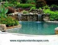 This would be my pool complete with a grotto Swimming Pool Waterfall, Swimming Pools Backyard, Pool Landscaping, Inground Pool Designs, Waterfall Lights, Pool Shapes, My Pool, Pool Fence, Beautiful Pools