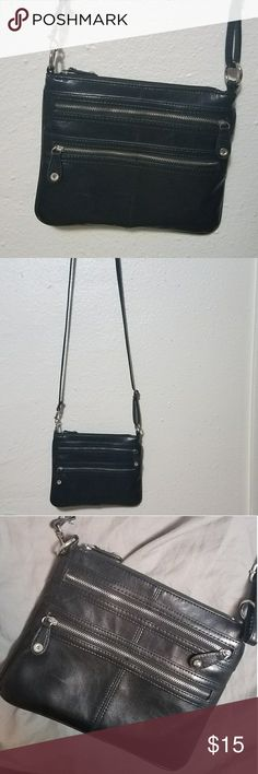 Little black purse! Faux leather. Lots of pockets. Zippers work great and its very clean. Holds the essentials! Not sure of the brand, it's re-posh. Merona Bags Crossbody Bags