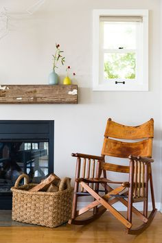 A leather rocking chair provides patina next to Katie Lowes's fireplace.