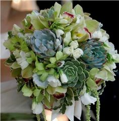 this is beautiful.  easily done.  it has cymbidium orchids and smaller dendrobium orchids- a little more expensive bouqet- might be best reserved for the bride or maid of honor to watch costs