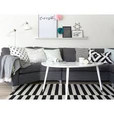 Black, white and grey livingroom with an IKEA Lövbacken coffee table