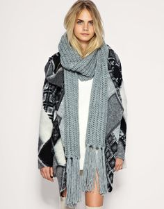 Comfy casual wear that can be also worn out. The printed sweater and chunky grey scarf are must have's for the winter.