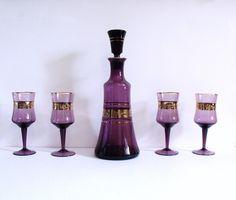 Vintage barware decanter and glasses, amethyst purple with gold trim, mid century modern liquor service. $59.00, via Etsy.