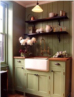 Green Kitchen Cabinets cabinetry and island are painted sherwin williams pewter green