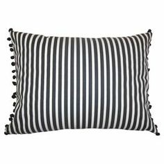 "Showcasing a stripe motif and pompom trim, this cotton pillow adds a perfectly patterned pop to your sofa or bed.   Product: PillowConstruction Material: Cotton cover and polyester fillColor:  Black and whiteFeatures:  Insert includedHidden zipper closureMade in the USA Stripe motifDimensions: 12"" x 16""Cleaning and Care: Spot clean"