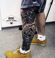 Stunning detail in this leg sleeve, at the top is a lion's head with it's tongue out, followed by a clock face merged with a skull. This guy's leg tattoo is by Vladimir Drozdov.