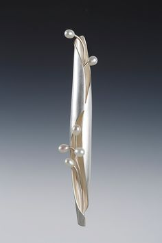 Sterling and pearl spiculum brooch.
