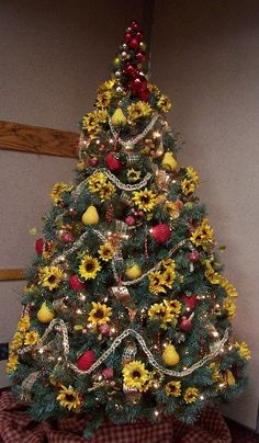 Now this is a tree that I like. All sunflowers and beaded fruit. I am especially fond of the twine garland one of my co-workers crocheted f...
