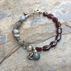 Labradorite and Garnet Bracelet with Faceted Labradorite Teardrop and Fleur de Lis Charm, Sterling Silver Hill Tribe Toggle Clasp