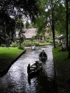 """giethoorn - a village in holland with no roads. visitors are always welcomed and encouraged to rent an electric and noiseless """"whisper boat"""" to explore this little piece of heaven on earth. SO COOL! by roslyn"""