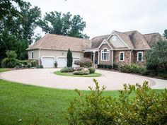Spacious custom built home on 3 acres in Pebble Creek. Tucked away in a wooded area sits this gorgeous home. The circular driveway three car garage and beautifully landscaped yard pull you in to want to see more. Walking into the foyer you will see the formal dining room to the left and an office equipped with rows of built in bookshelves to the right. Off of the formal dining room sits the custom kitchen keeping room breakfast area and sunken sun room. The kitchen features custom cream ...