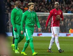 The Pogba brothers - Florentin (left) and Paul -take to the field as the two sides prepared for the usual pre-match handshakes