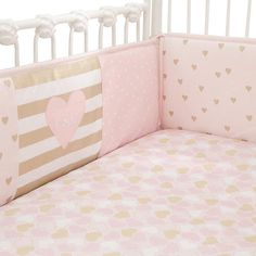 This four piece perfect fit crib bumper was designed exclusively for Babies R Us by Lambs & Ivy®. A lovely patchwork design in petal pink, metallic gold, and soft white are featured in sweet hearts, wide stripes, and ever popular chevrons. Fabrics are a combination of cotton and polyester. There are 24 sets of ties which need to be securely tied to the outside of the crib for safe sleep. Polyester fiberfill. Care Instructions: Machine wash cold with like colors. Gentle cycle. Do not bleac...