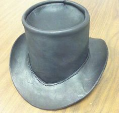 I've wanted a leather top hat ever since I saw them at the Georgia Renaissance Festival. The one I saw that inspired me to make one myself wasn't quit...