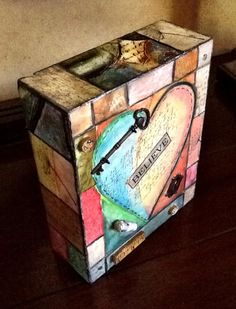 Art Block made during Art & Soul retreat in Las Vegas with Lisa Kaus.  This is wood block prepared with gesso and molding paste, then painted, water crayons, and adding paper and embellishments and finished with layer of beeswax.  Fun to make!